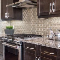 Medium 21117513533681 monet   gallery at larch park   kitchen with solid maple cabinets quartz counters sparkling tile backsplash