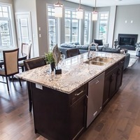 Medium 670140052679926 monet   gallery at larch park   kitchen island with double sink upgraded faucet and dishwasher