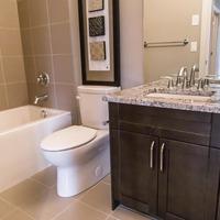 Medium 407101911492645 monet   gallery at larch park   guest bathroom fully tiled shower  tub quartz counters