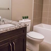 Medium 956268124748021 monet   gallery at larch park   developed basement includes guest bathroom with quartz counters tiled shower